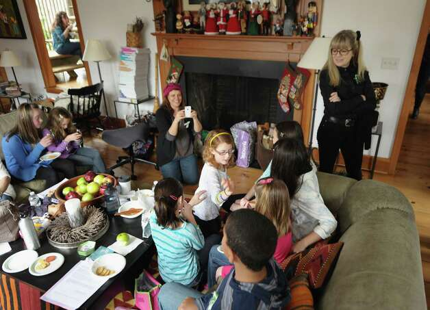 "Tina Weymouth of the Talking Heads (R) watches as children of Newton, CT take a break from performing ""A Song From Sandy Hook"" with Ingrid Michaelson at Weymouth's home on January 14, 2013 in Fairfield, Connecticut. Photo: Michael Loccisano, Getty Images For Tim Hayes / 2013 Getty Images Connecticut Post contributed"