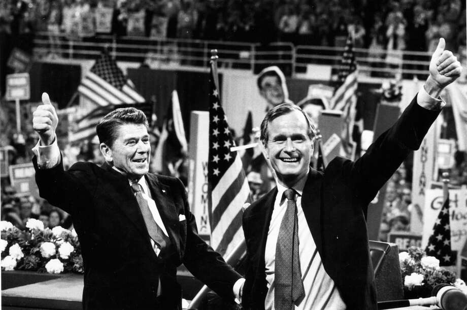 "George H. W. Bush, shown here running for vice president with Ronald Reagan, took Reagan to task before he was selected as the other man's running mate. Bush is credited with coining the term ""voodoo economics,"" in reference to Reagan's economic policy.  Photo: Joe Kennedy, McClatchy-Tribune News Service / Los Angeles Times"