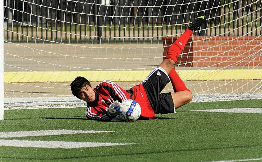 Atascocita goalie Gilberto Betancourt dives for a shot on goal during the Atascocita and Westide soccer game at the Cy-Fair ISD Soccer Tournament at the Berry Center. Photo by David Hopper Photo: David Hopper, Freelance / freelance