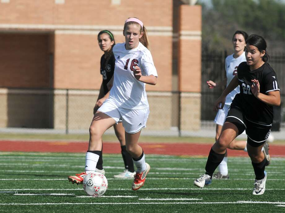 Magnolia senior midfielder Valerie Turner, left, controls the ball against Galena Park. Freelance photo by Jerry Baker Photo: Jerry Baker, Freelance