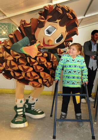 The Woodlands mascot Puffy Pine Cone gives Zoe Nobile, of The Woodlands, a thumbs up of encouragement as Zoe ice skates at the Ice Rink. Puffy will celebrate his birthday with area kids at Rob Fleming Park on Jan. 18.The Woodlands mascot Puffy Pine Cone gives Zoe Nobile, of The Woodlands, a thumbs up of encouragement as Zoe ice skates at the Ice Rink. Puffy will celebrate his birthday with area kids at Rob Fleming Park on Jan. 18. Photo: David Hopper, Freelance / freelance