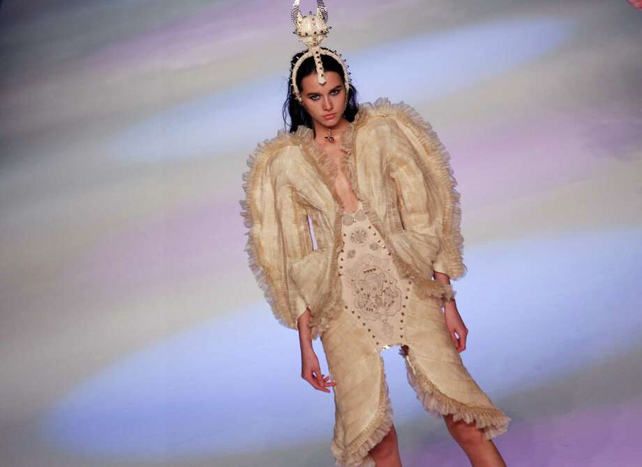She's obviously the queen or empress of something, but it's hard to look stately when you're wearing shorts. A model presents a creation by Hong Kong designer Chan Kit Leung during the Young Designers Contest during the Hong Kong Fashion Week in Hong Kong, Tuesday, Jan. 15. Photo: Vincent Yu, Associated Press / AP