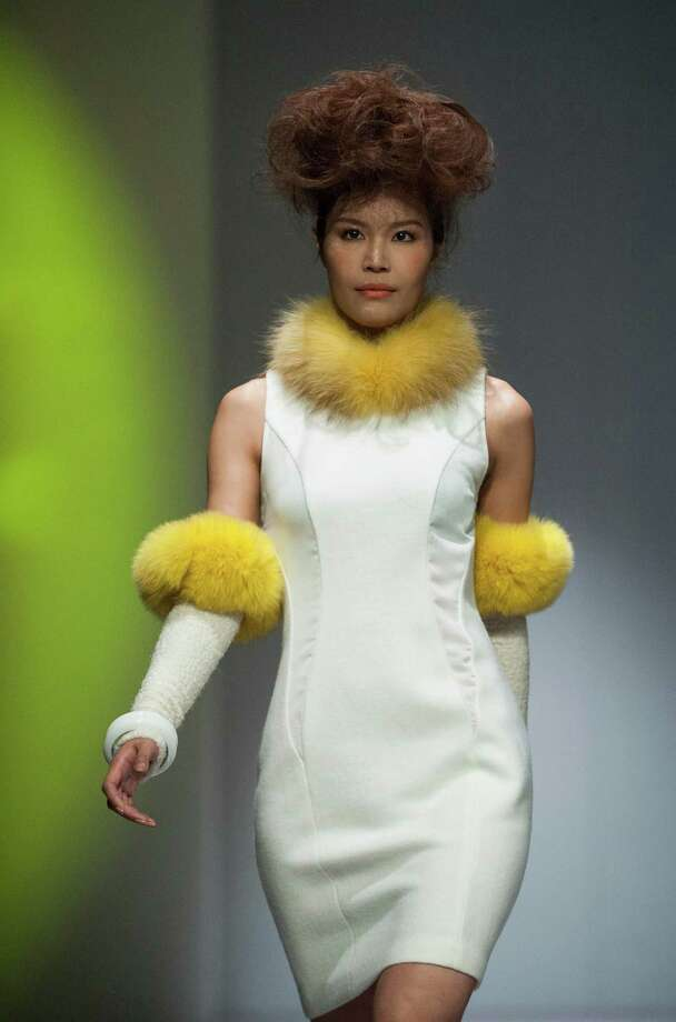 The gloves double as  Swiffer dusters. A model showcases designs on the runway by Ho Kin Wah during the Inner Symphony of Style show on day 1 of Hong Kong Fashion Week Autumn/Winter 2013 at the Convention and Exhibition Centre on January 14. Photo: Victor Fraile, Getty Images / 2013 Getty Images