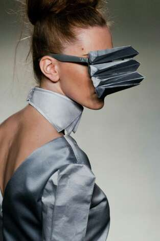 Haven't we seen Kanye West wearing these sunglasses? A model displays a creation of Ella Zhang during the 'Floating Geometry' show as part of the Hong Kong Fashion Week Spring/Summer 2011 at the Hong Kong Convention and Exhibition Center on July 7, 2010 in Hong Kong, China. Photo: Victor Fraile, Getty Images / Getty Images AsiaPac