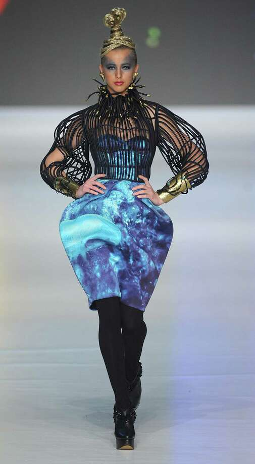 Fashion designers find inspiration everywhere, including bug zappers. A model wears a creation by Indonesian fashion designer Ali Charisma during Hong Kong Fashion Week in 2010.  Photo: MIKE CLARKE, AFP/Getty Images / AFP