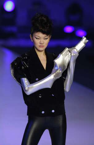 Any fashionable ray gun enthusiast will tell you that you don't want to destroy your shirt while shooting alien invaders. Three-quarter sleeves would be a better option. A model displays a creation by Hong Kong designer Baldwin Pui at the annual Hong Kong Fashion week Tuesday, Jan. 19, 2010 in Hong Kong. Photo: Kin Cheung, AP / AP