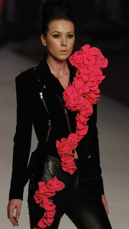 We were ok with the large floral seatbelt thing at first, until we noticed that part of it is shoved through what appears to be a bottomless pants pocket.