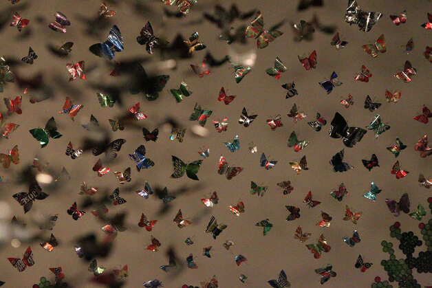 Aluminum cans cut in the shape of butterflies make up part of Anita Valencia's exhibit currently on display at the Southwest School of Art's Russell Hill Rogers Gallery. Photo: JOHN DAVENPORT, San Antonio Express-News / ©San Antonio Express-News/Photo Can Be Sold to the Public