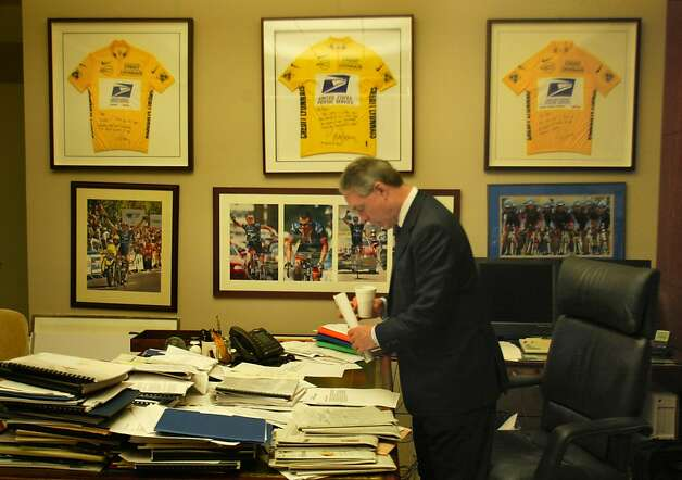 Weisel checks his morning mail beneath the three jerseys. Thom Weisel, CEO of  the SF investment firm Thomas Weisel Partners has his office wall full of Lance Armstrong photos including 3 framed yellow jerseys presented to him by his friend Lance Armstrong.Weisel now needs to make room for the 4th jersey. A profile on Weisel who is an accomplished cyclist himself and a huge success in the business world despite the tough economic times.  CHRONICLE PHOTO BY MICHAEL MALONEY Photo: Michael Maloney, SFC