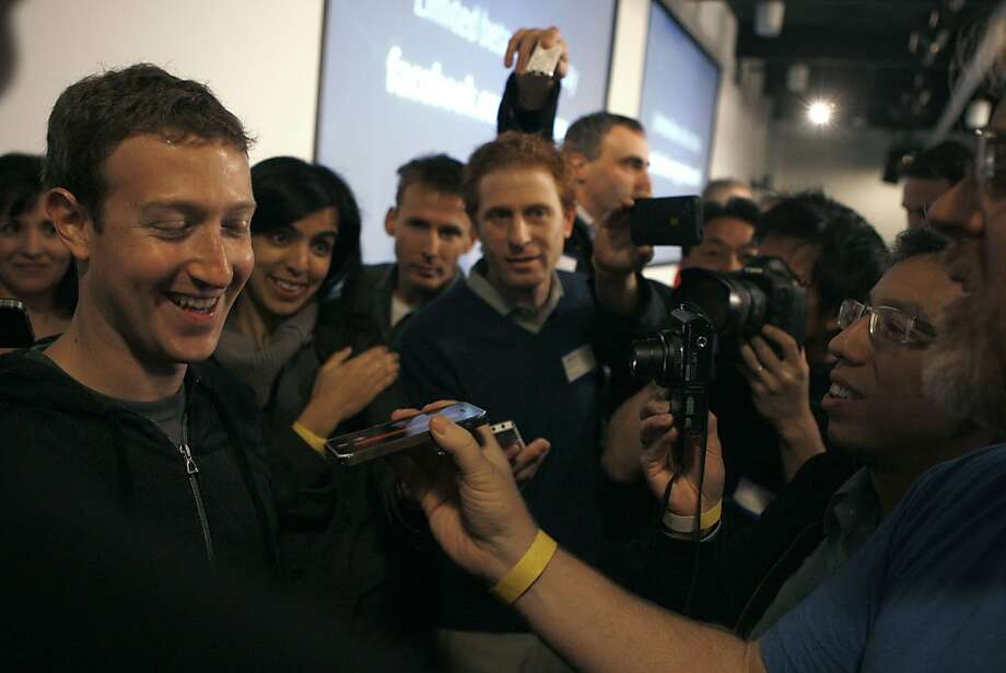 Facebook chief executive Mark Zuckerberg talks with press after introducing Graph Search. Photo: Liz Hafalia, The Chronicle