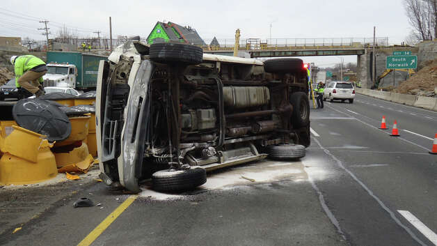 A cargo van rolled over on I-95 northbound in Norwalk, Conn. on Tuesday, Jan. 15, 2012. The driver suffered minor injuries. Photo: Contributed Photo