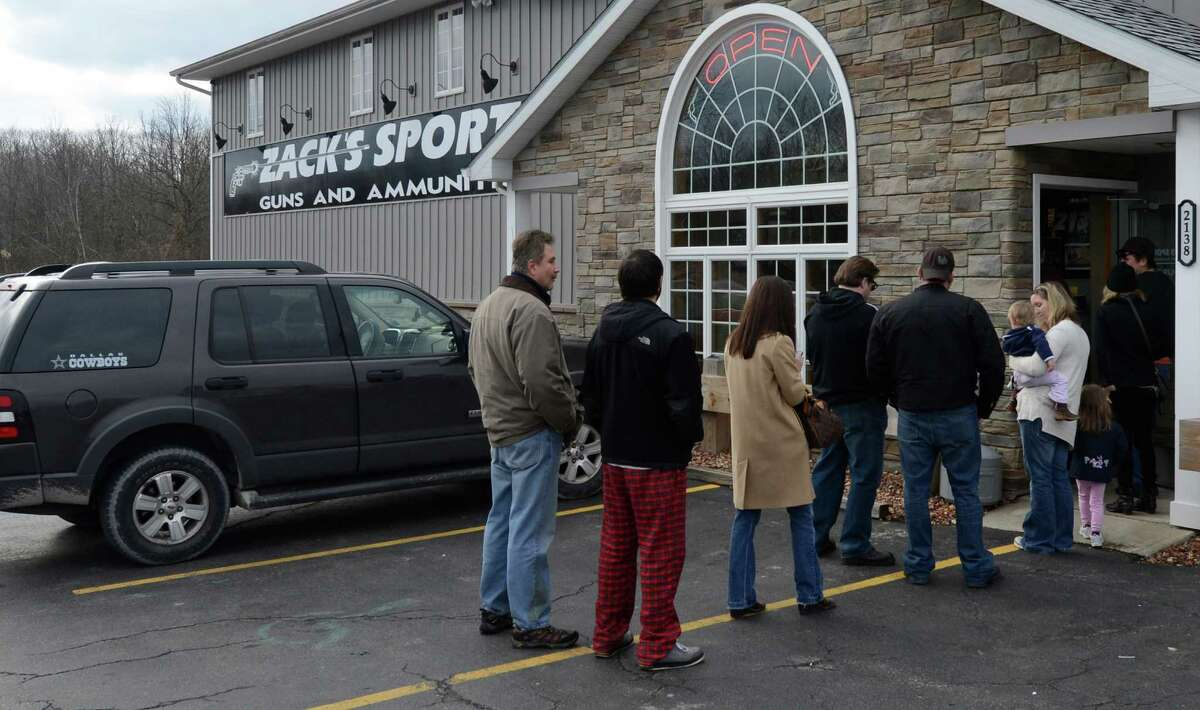 Patrons of Zack's Sports line up Tuesday morning Jan. 15, 2013, in Round Lake, N.Y., for the possible purchase of guns and ammo on the day that new more restricting gun laws may be signed by Governor Cuomo. (Skip Dickstein/Times Union)