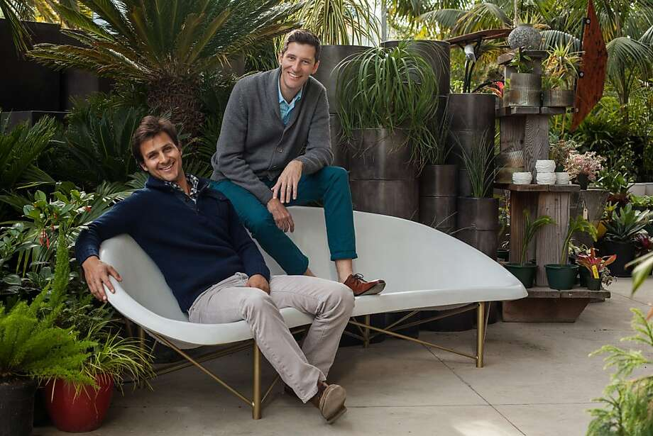 Designers Aaron Jones (left) and David Covell sit on one of their heated Helios Lounges at Flora Grubb Gardens in San Francisco. Photo: Peter Prato