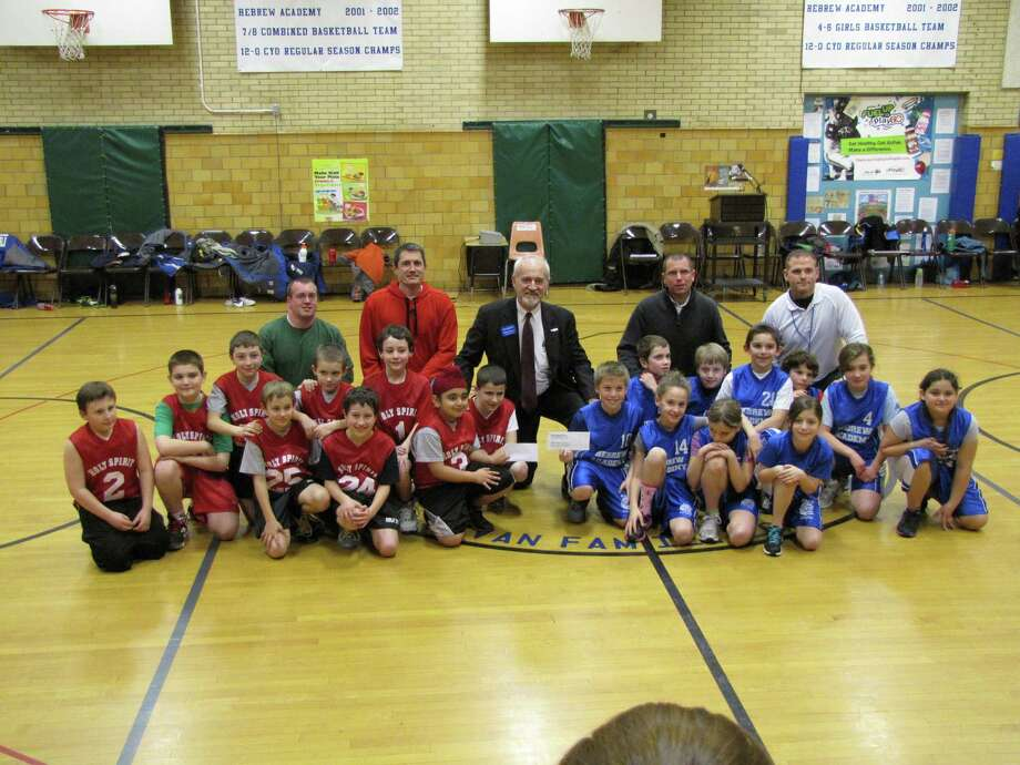 PROVIDED PHOTO BASKETBALL TEAMS from Bet Shraga Hebrew Academy and Holy Spirit School raised more than $1,000 for the Make-A-Wish Foundation of Northeast NY.