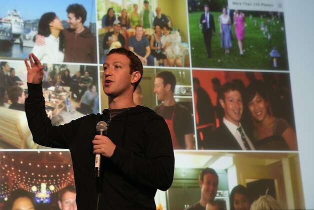 "Snapshots of Zuckerberg are displayed on a screen behind the CEO as he makes what he called Facebook's ""first big product announcement."" Photo: Liz Hafalia, The Chronicle"