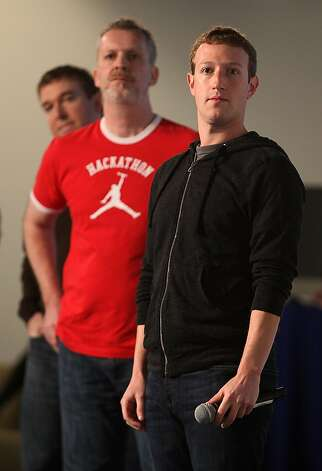 Facebook chief executive Mark Zuckerberg (right) taking questions about his new Facebook feature Graph Search during a presentation at Facebook headquarters in Menlo Park, Calif., on Tuesday, January 15, 2013. At left is product manager Tom Stocky (left) and product engineer Lars Rasmussen (middle) Photo: Liz Hafalia, The Chronicle