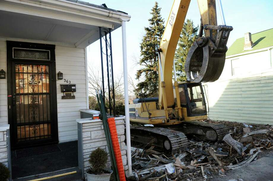 A house at 365 9th Street is demolished on Thursday, Jan. 10, 2013, in Troy, N.Y. (Cindy Schultz / Times Union) Photo: Cindy Schultz / 00020723A