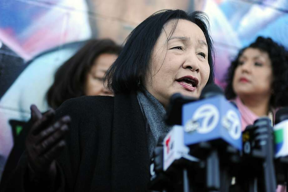 Oakland Mayor Jean Quan stands in front of a mural of 3 year old homicide victim Carlos Nava on International Blvd. as she addresses the gathered media.  Oakland police, Mayor Jean Quan and City Administrator held a news conference to discuss the ongoing violence gripping Oakland, Monday January 14th, 2013. Photo: Michael Short, Special To The Chronicle