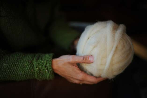 Harmeet Dhillon of San Francisco founded Sea Ranch Woolworks, which employs local knitters, above, uses natural dyes and gets its wool from sheep used in the fire abatement program. Photo: Erik Castro, Special To The Chronicle