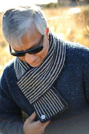 Her husband, Sarvjit Randhawa, wears a scarf and sweater she knitted. Photo: Erik Castro, Special To The Chronicle