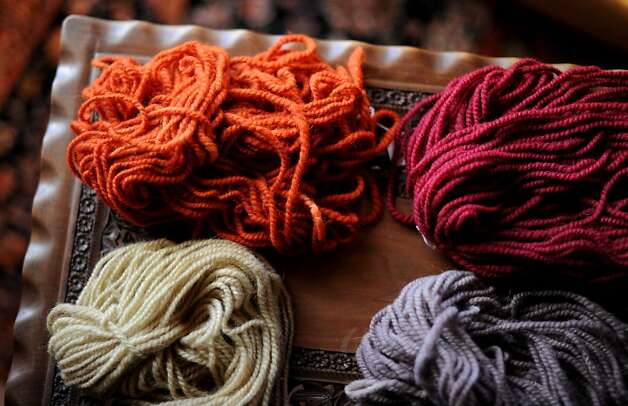 Harmeet Dhillon of San Francisco founded Sea Ranch Woolworks, which employs local knitters, left, uses natural dyes and gets its wool from sheep used in the fire abatement program. Photo: Erik Castro, Special To The Chronicle