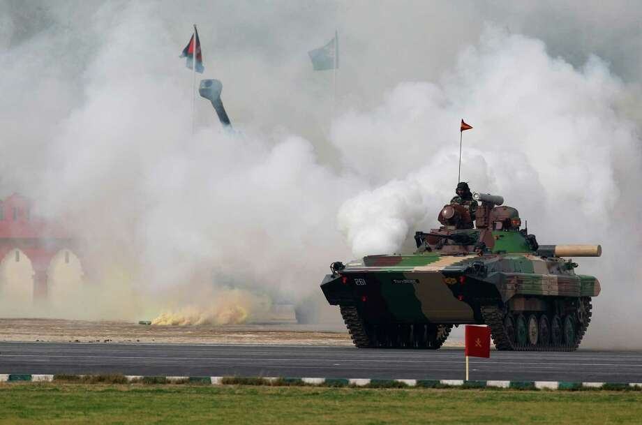 Indian army soldiers conduct a mock drill during an event to mark Indian Army Day in New Delhi, India, Tuesday, Jan. 15, 2013.  Indian Army Day is an annual event honoring the military. (AP Photo/Tsering Topgyal) Photo: Tsering Topgyal, STR / AP
