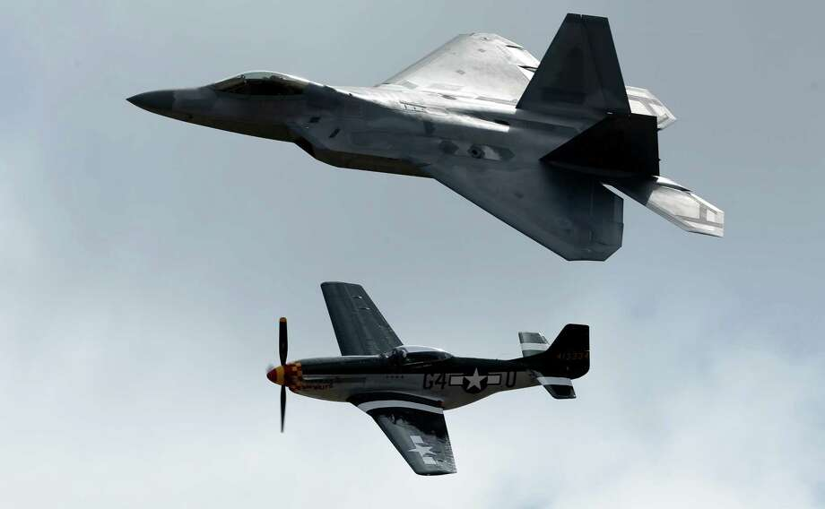 An F-22 Raptor, above, flies with a P-51 Mustang during the Miramar Air Show Friday, Oct. 12, 2012, in San Diego. Photo: Gregory Bull, Associated Press / Associated Press