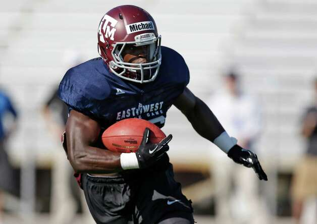 West running back Christine Michael, of Texas A&M, during practice for the East West Shrine football game Tuesday, Jan. 15, 2013, in St. Petersburg, Fla. The West squad takes on the East on Saturday afternoon. (AP Photo/Chris O'Meara) Photo: Chris O'Meara, Associated Press / AP