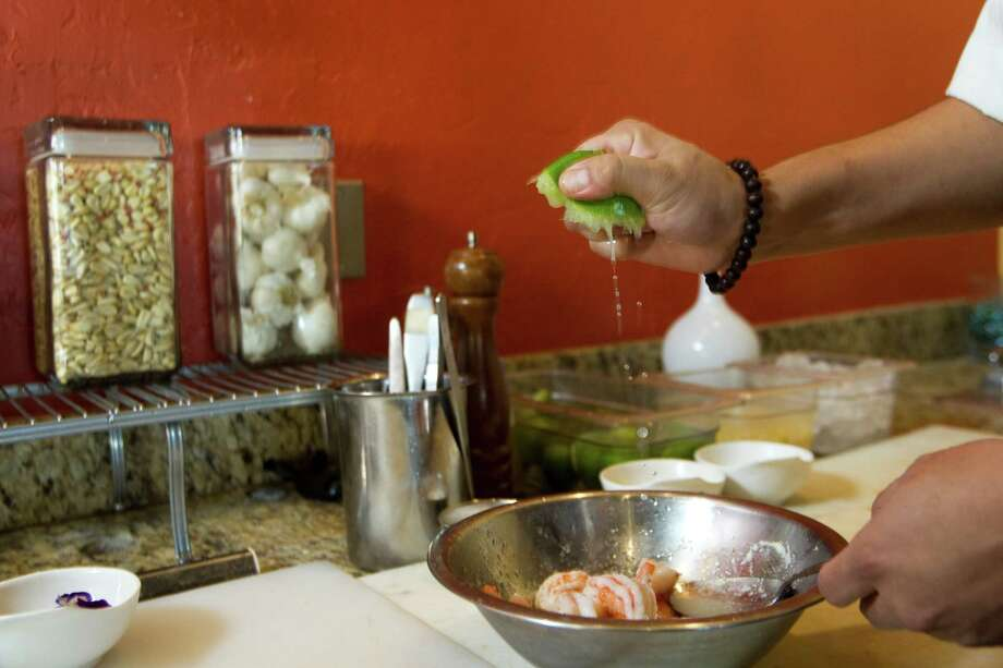 Chef David Guerrero prepares Cebiche de Camaron.. Photo: Brett Coomer, Houston Chronicle / © 2012 Houston Chronicle