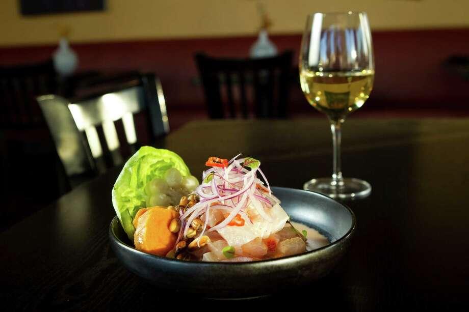Cebiche de Limeño and some wine.  Photo: Brett Coomer, Houston Chronicle / © 2012 Houston Chronicle
