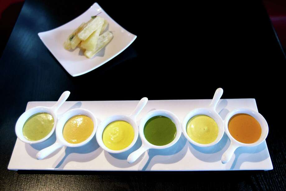 Salsa tasting tray with yucca fries. Photo: Brett Coomer, Houston Chronicle / © 2012 Houston Chronicle