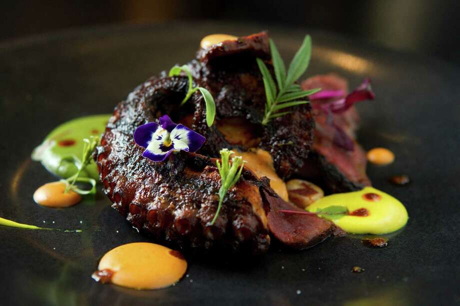 Anticucho Mixto, a dish of char-grilled octopus and beef heart. Photo: Brett Coomer, Houston Chronicle / © 2012 Houston Chronicle