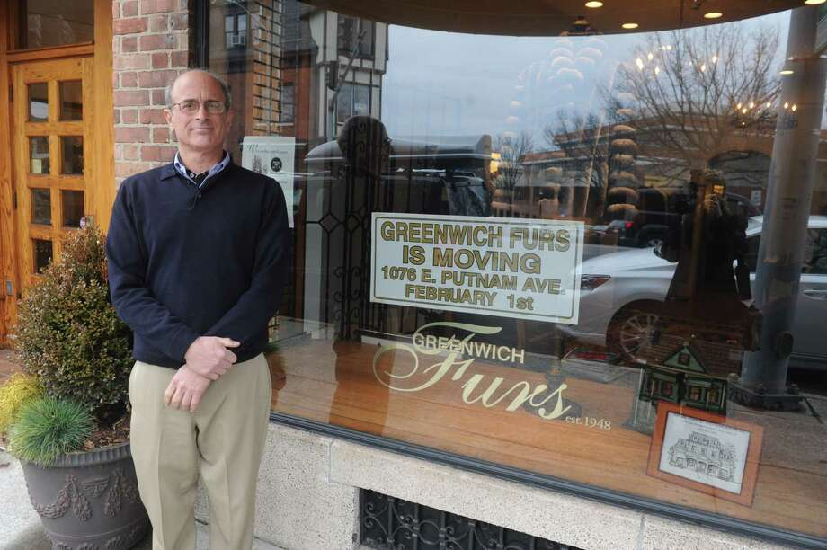 Nick Tsamisis, owner of Greenwich Furs, who is moving his business from 5 W. Putnam Ave., to 1076 E. Putnam Ave., by Feb. 1. The store has been there 65 years. Tsamisis stands in front of his store Tuesday, Jan. 15, 2013. Photo: Helen Neafsey / Greenwich Time
