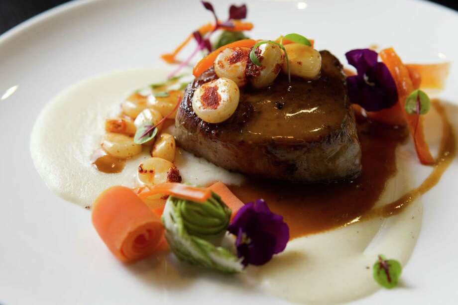 "Lomo ""Filet"" is shown at Alma Cebiche. Photo: Brett Coomer, Houston Chronicle / © 2012 Houston Chronicle"