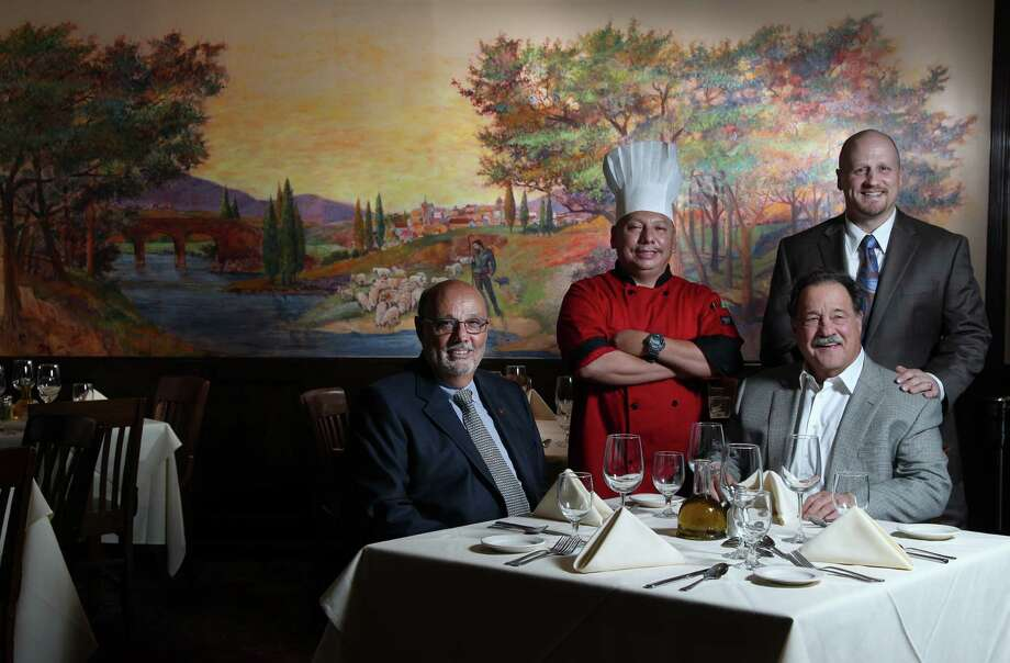 Bubba Butera, from left, chef Napoleon Palacios, Frankie B. Mandola and Johnny Mandola are behind Damian's Cucina Italiana, which is marking its 30th anniversary with a yearlong  celebration of specials. Photo: Mayra Beltran, Staff / © 2012 Houston Chronicle