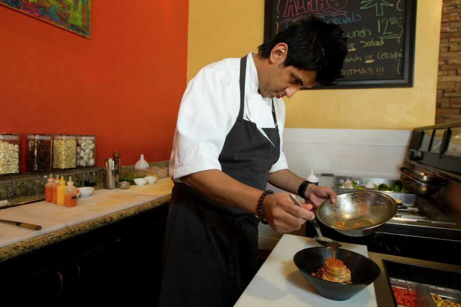 Chef David Guerrero prepares Cebiche de Camaron. Photo: Brett Coomer, Houston Chronicle / © 2012 Houston Chronicle
