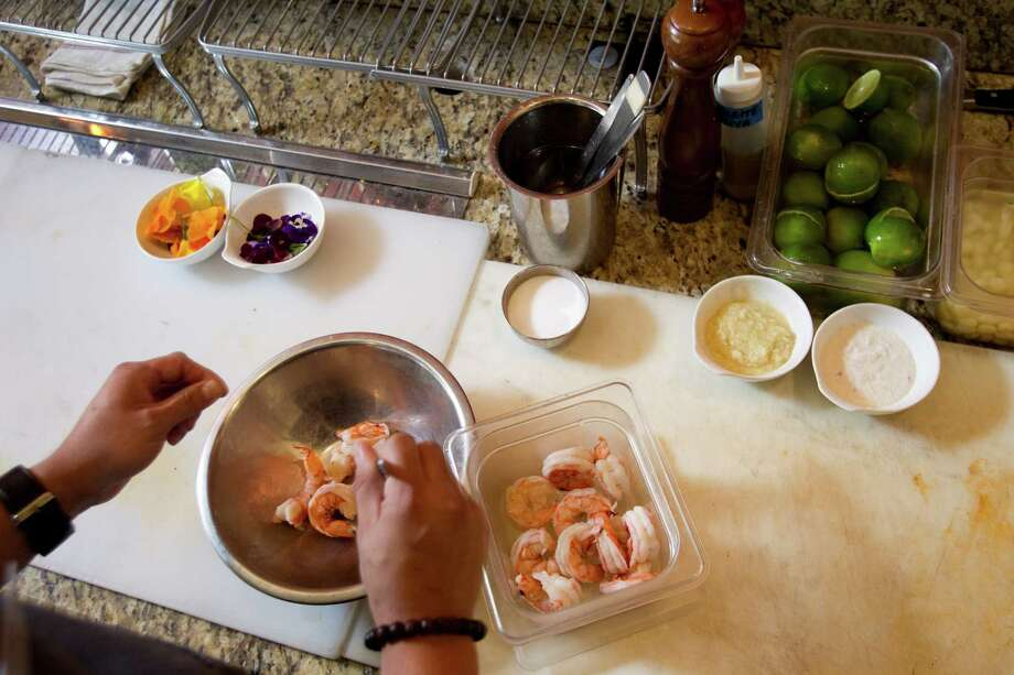 Chef David Guerrero gets the shrimp ready. Photo: Brett Coomer, Houston Chronicle / © 2012 Houston Chronicle