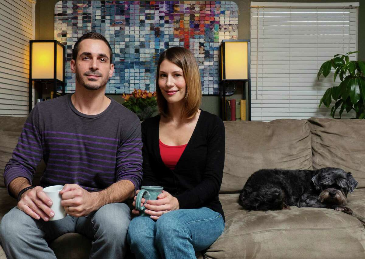 """Franklin and Stephanie Lyons, the couple behind SpinFall game apps, relax in their San Antonio home. They have developed a hit game app called """"Frog on Ice."""""""