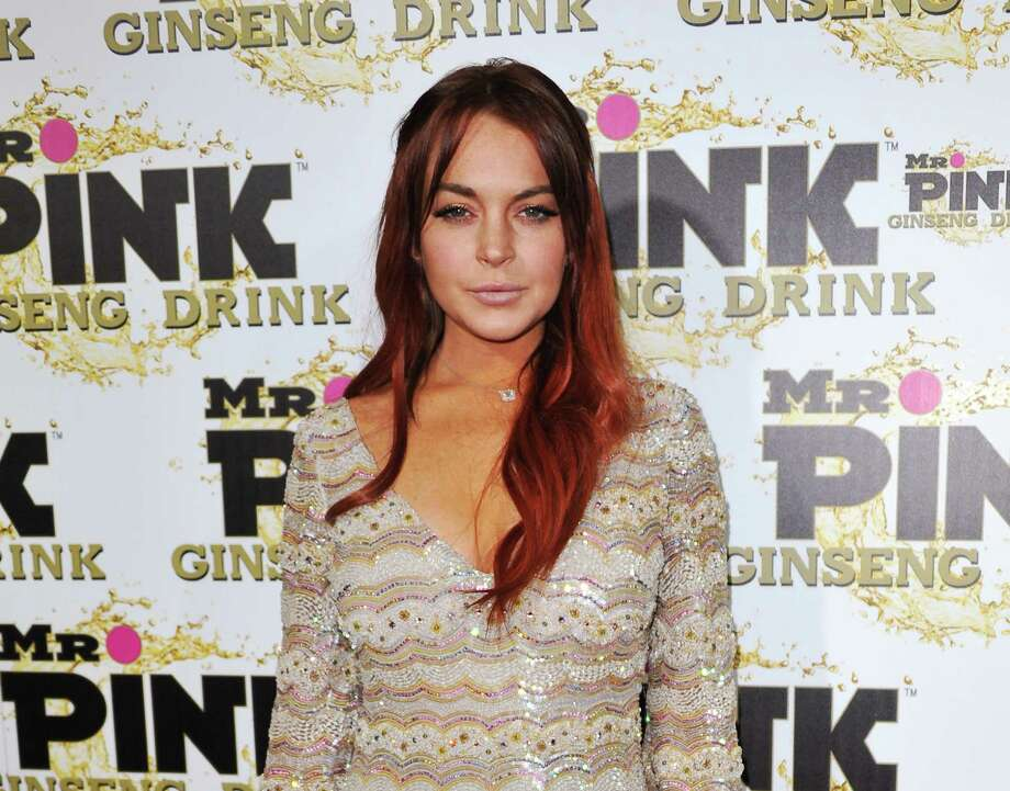 FILE - In this Oct. 11, 2012 file photo, Lindsay Lohan attends the Mr. Pink Ginseng launch party at the Beverly Wilshire hotel in Beverly Hills, Calif.  Lohan's misdemeanor case is due to be called for arraignment in Los Angeles on Tuesday, January 15, 2012. The actress is charged with lying to police, reckless driving and obstructing a police officer from performing his duties. (Photo by Richard Shotwell/Invision/AP, File) Photo: Richard Shotwell