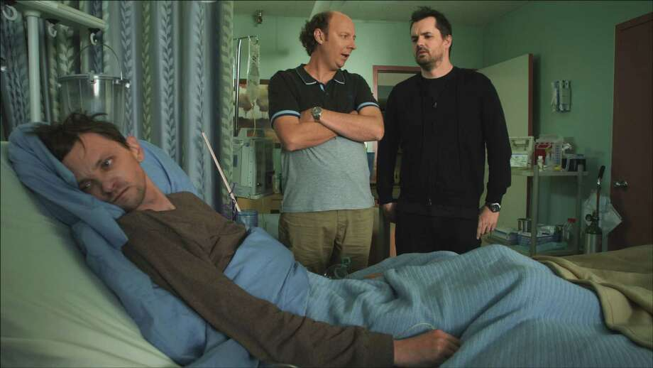 "In spite of being confined to a wheelchair, Billy (D.J. Qualls, left) just wants to enjoy the pleasures of life. In the new FX sitcom ""Legit,"" Steve (Dan Bakkedahl) and Jim (Jim Jefferies, right) want to help him do just that. Photo: Handout / ONLINE_YES"