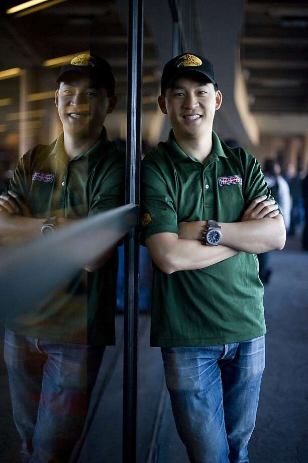 """Winner of the latest installment of the History Channel's sport shooting program """"Top Shot"""", Chris Cheng of San Francisco poses for a portrait while attending the convention.   SHOT Show, the world's largest gun show, opened at the Sands Convention Center in Las Vegas, NV on Tuesday January 15th, 2013, where an estimated 60,000 industry enthusiasts are expected to attend. Photo: Michael Short, Special To The Chronicle"""
