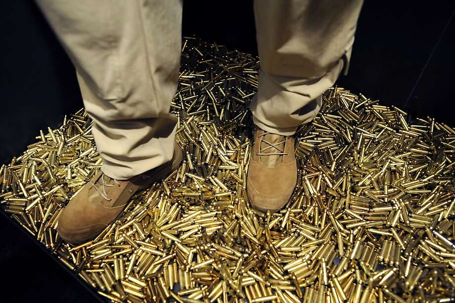 Empty bullet casings are seen in a display at the Crye Precision booth.    SHOT Show, the world's largest gun show, opened at the Sands Convention Center in Las Vegas, NV on Tuesday January 15th, 2013, where an estimated 60,000 industry enthusiasts are expected to attend. Photo: Michael Short, Special To The Chronicle