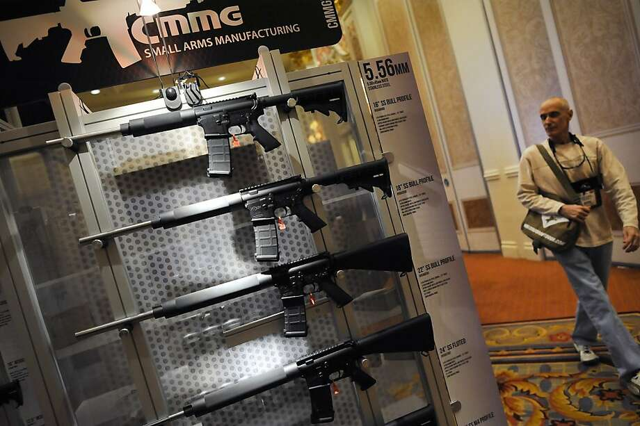 A display of various weapons is seen at the booth of CMMG Small Arms Manufacturing.  SHOT Show, the world's largest gun show, opened at the Sands Convention Center in Las Vegas, NV on Tuesday January 15th, 2013, where an estimated 60,000 industry enthusiasts are expected to attend. Photo: Michael Short, Special To The Chronicle