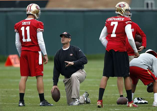 Head coach Jim Harbaugh, (center) works with quarterbacks Alex Smith, (11) and Colin Kaepernick, (7), as the San Francisco 49ers hold practice at their training facility on Wednesday Jan. 9,  2013, in Santa Clara, Calif., in preparation of NFC playoff game against the Green Bay Packers this weekend. Photo: Michael Macor, The Chronicle
