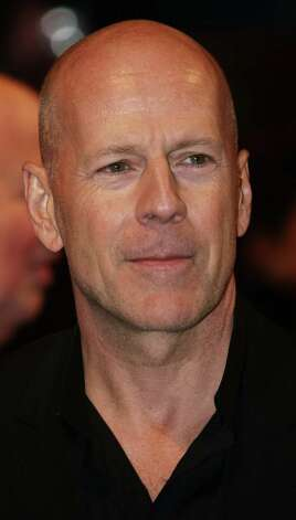 "Bruce Willis has fallen victim to an ailment that affects all parents at one time or another – the belief that your tales of child-raising are as amusing to everyone else as they are to you. It's evidenced by a recent demonstration the British show ""Daybreak,"" in which Willis shows how he entertains his daughter by taking a drink of water and spits it out on the floor. Amusing for his baby girl, perhaps, but not for anyone else. And we have to wonder, does Bruce have carpets or hardwood floors?  Photo: MAX NASH, Stringer / AFP"