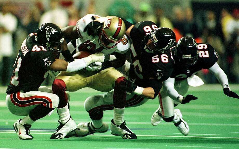 Several Falcons gang up on Terrell Owens in Atlanta's 20-18 win in the divisional-round playoff game following the 1998 season. The week before, Owens' last-second TD catch beat Green Bay. Photo: Michael Maloney, CHRONICLE