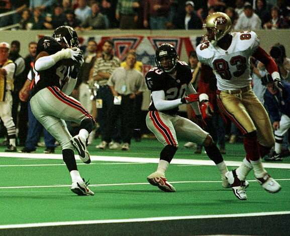 49ERS-INTERCEPTION/C/09JAN99/SP/MJM Eugene Robinson intercepts a pass intended for #83 JJ Stokes at the 1 yard line in the3rd quarter. #20 is Michael Booker. The 49ers lost to Atlanta 20-18 at the Georgia Dome. CHRONICLE PHOTO BY MICHAEL MALONEY Photo: Michael Maloney, CHRONICLE