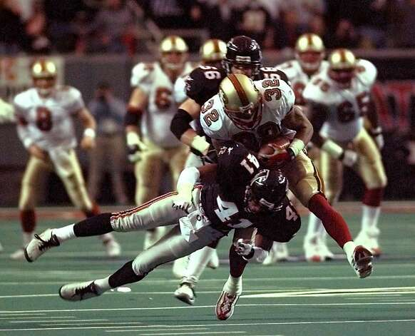 San Francisco 49ers running back Chuck Levy makes the reception despite pressure from Atlanta Falcons' safety Eugene Robinson in the playoff game at the Georgia Dome in Atlanta, Ga., Saturday, Jan 9, 1999. The Falcons defeated the 49ers 20-18 to advance to the NFC Championship game. (AP Photo/Ed Reinke) Photo: Ed Reinke, Associated Press