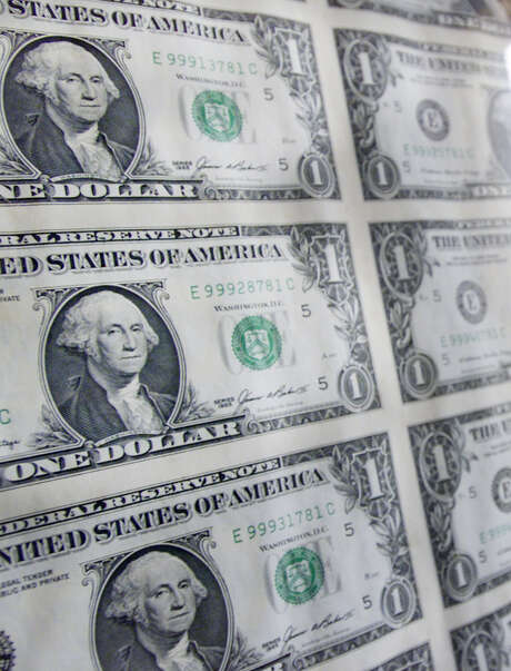 **FOR USE WITH AP LIFESTYLES**   **FILE**   A sheet of one dollar bills hangs inside the Gilbert Stuart Birthplace and  Museum in the village of Saunderstown in North Kingstown, R.I., birthplace of American painter Gilbert Stuart, in this Thursday, May 16, 2002 file photo.  Stuart's portrait of George Washington is the one that's on the $1 bill.    (AP Photo/Victoria Arocho, FILE) Photo: VICTORIA AROCHO, STF / AP