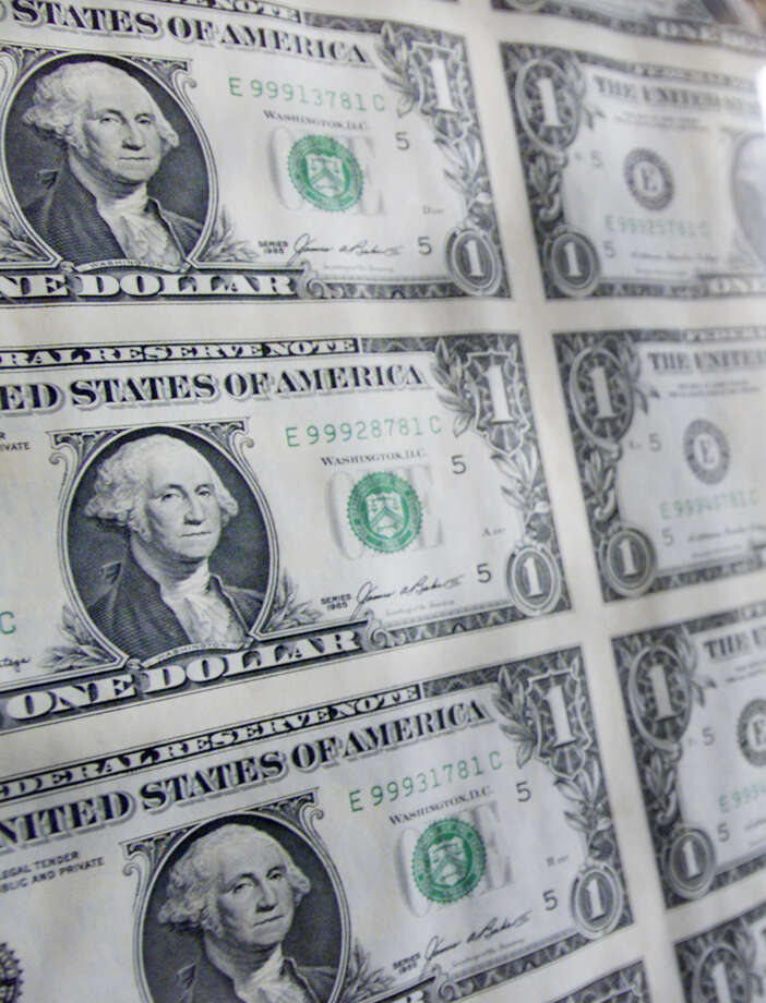 George Washington is on the dollar bill. You can't get much baller than that.  Photo: VICTORIA AROCHO, STF / AP